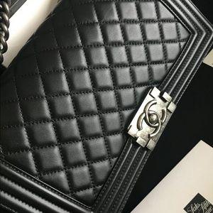 Black Medium Chanel boy bag.